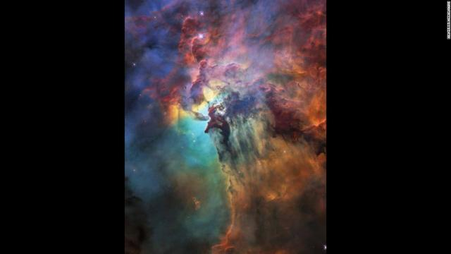 The NASA/ESA Hubble Space Telescope is celebrating its 28th anniversary in space with this stunning and colorful image of the Lagoon Nebula 4,000 light-years from Earth. While the whole nebula is 55 light-years across, this image only reveals a portion of about four light-years.