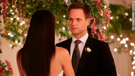 Mike (Patrick J. Adams) and Rachel (Meghan Markle) make it official.