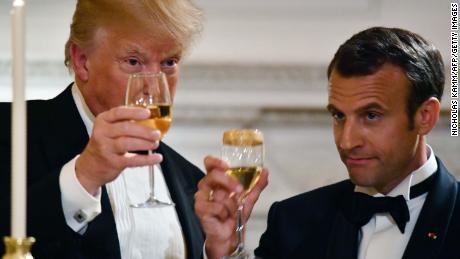 Trump jets to Paris, leaving political tumult behind