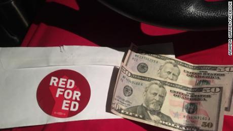 A stranger gave a Colorado grocery cashier $100 when he learned she's also a 3rd-grade teacher