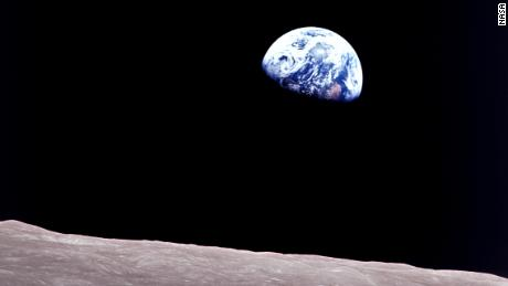 "Apollo 8 astronaut Bill Anders took this breathtaking photo of the ""Earthrise"" over the moon's landscape."