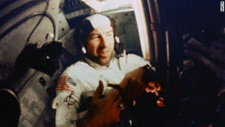 Navigator Jim Lovell works inside Apollo 8's cramped quarters.