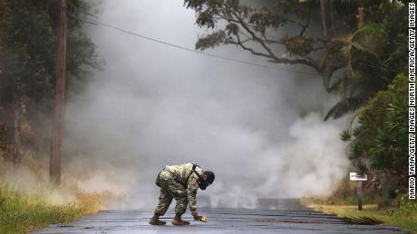 Army National Guard First Lt. Aaron Hew Len measures sulfur dioxide gas Tuesday in Leilani Estates.