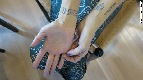 """During her cancer fight, Erika and her twin sister got matching tatoos with one message: """"Be brave."""""""