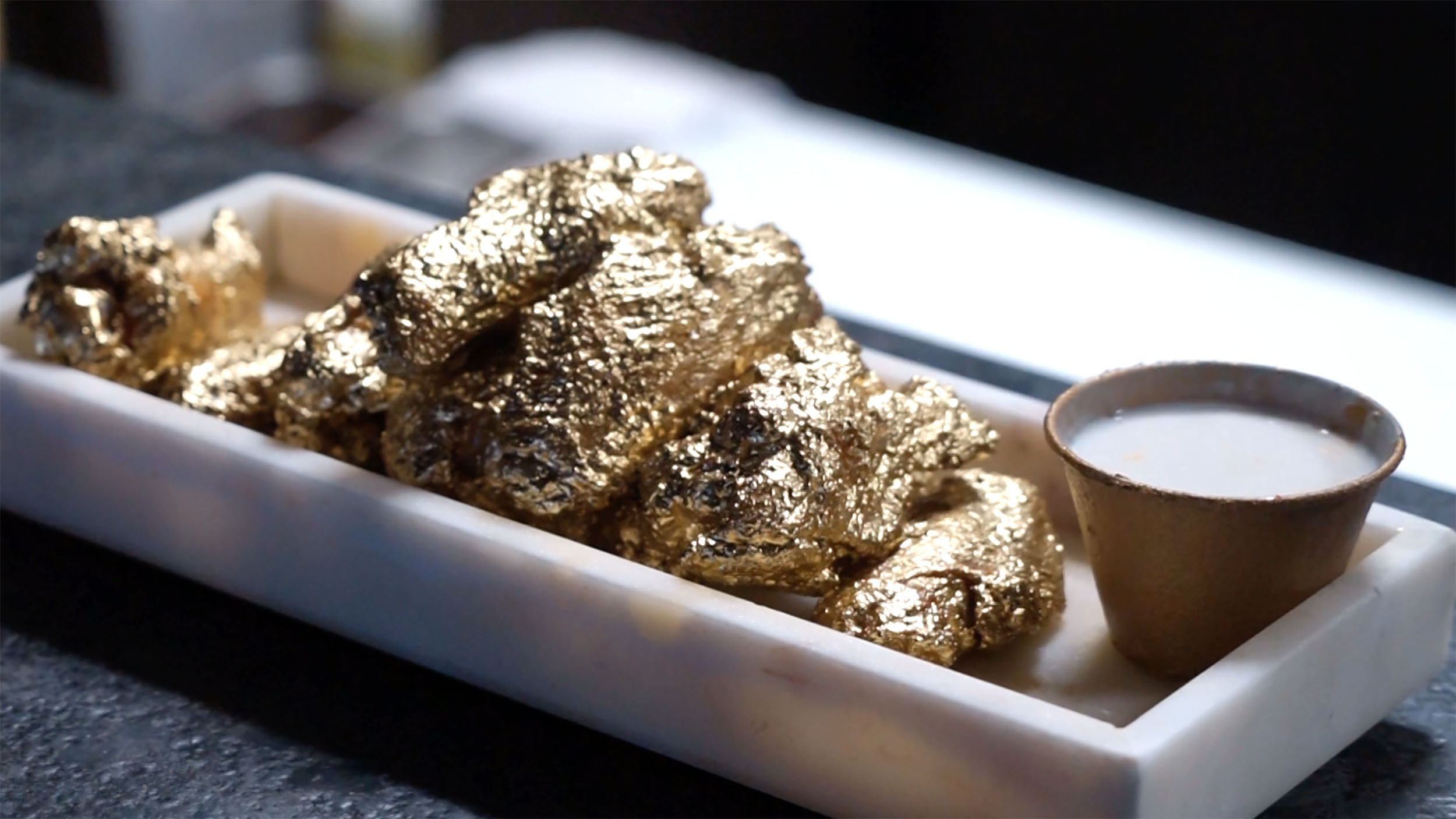 Image result for 24K gold chicken wings are NYC's latest weird food craze