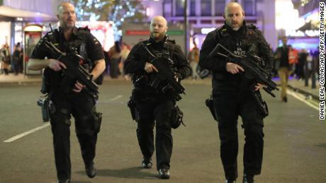 Armed police patrol near Oxford Street in central London in November.