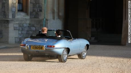 The Duke and Duchess of Sussex leave Windsor Castle in an E-Type Jaguar. The registration plate bore the date of their wedding day.