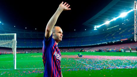As the confetti settled and the Barcelona faithful returned home, Iniesta couldn't bring himself to leave