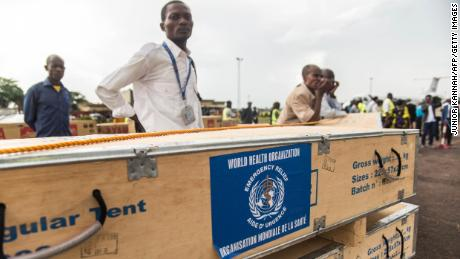 A health official supervises World Health Organization medical supplies at the airport in Mbandaka, Congo.