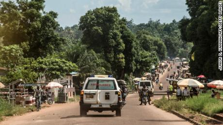 An ambulance carries an Ebola victim to a burial site in Mbandaka.