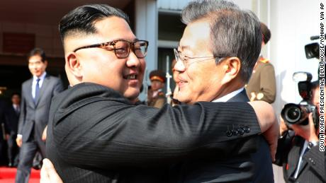 A photo provided by South Korea Presidential Blue House shows Kim Jong Un and Moon Jae-in hugging Saturday.