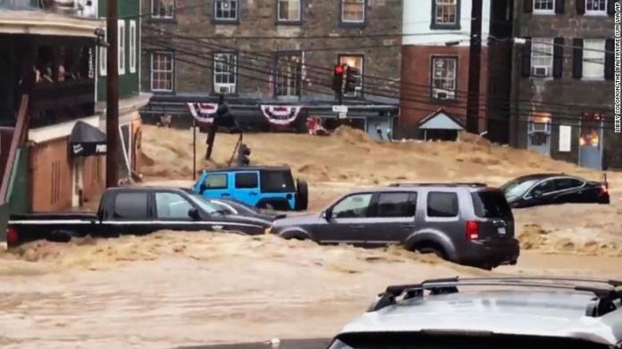 Floodwaters swept away vehicles and prompted about 30 water rescues in Ellicott City.