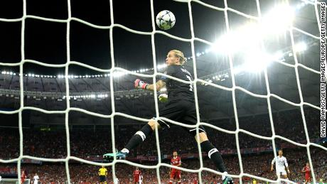 Karius of Liverpool watches the ball cross the line as he concedes for the third time.