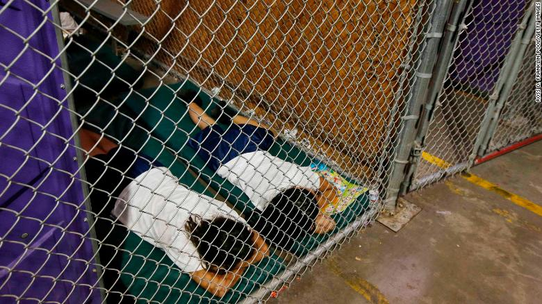Two female detainees sleep in a holding cell at a US Customs and Border Protection facility in Nogales, Arizona, in 2014.