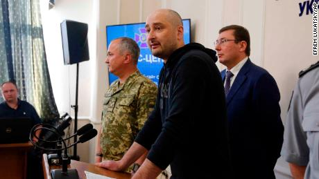 Arkady Babchenko, center, speaks to the media as Vasily Gritsak, head of the Ukrainian Security Service, left, and Ukrainian Prosecutor General Yuriy Lutsenko attend a news conference Wednesday.