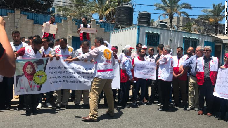 Palestinian medical workers protest outside a UN office in Gaza City.