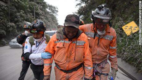 Volunteer firefighter cries after leaving a rescue site in Escuintla.