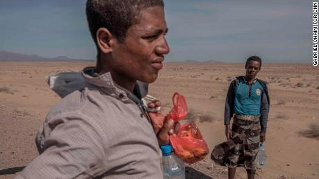 Ethiopian migrants on the road along the western coast of Yemen, walking toward Saudi Arabia.