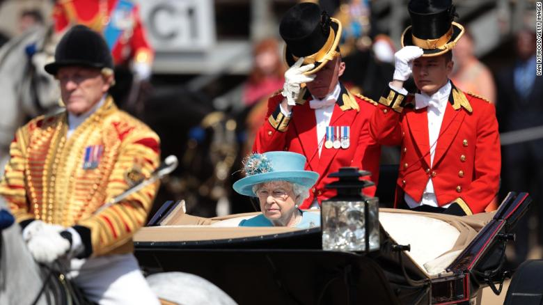 Queen Elizabeth II rides in an open carriage Saturday in the Trooping the Colour parade in London.