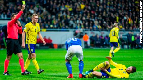 Marco Verratti of Italy is shown a yellow card for his foul on Marcus Berg of Sweden during the FIFA 2018 World Cup Qualifier