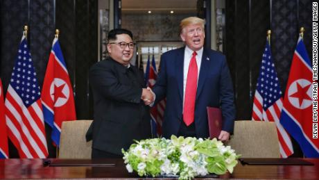 Kim Jong Un and Donald Trump shake hands during their summit in Singapore on June 12.