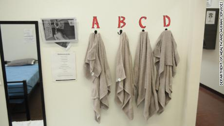 Towels hang on a wall at the shelter, where more than 1,400 undocumented boys are currently housed.