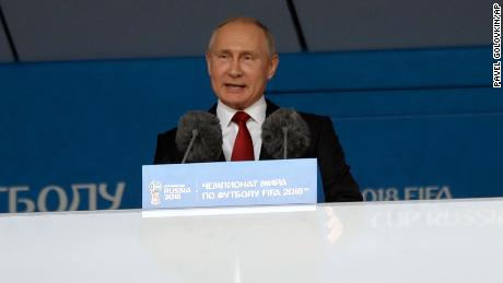 Russian President Vladimir Putin speaks prior Group A opener