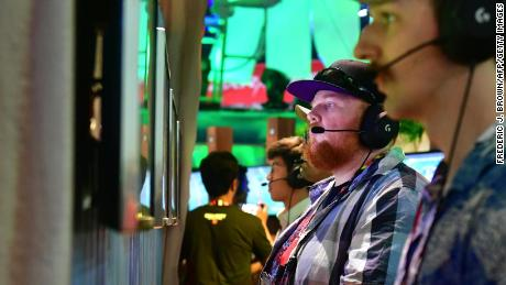 "Gamers play ""Fortnite"" on PS4 consoles at E3 2018 in Los Angeles, California."