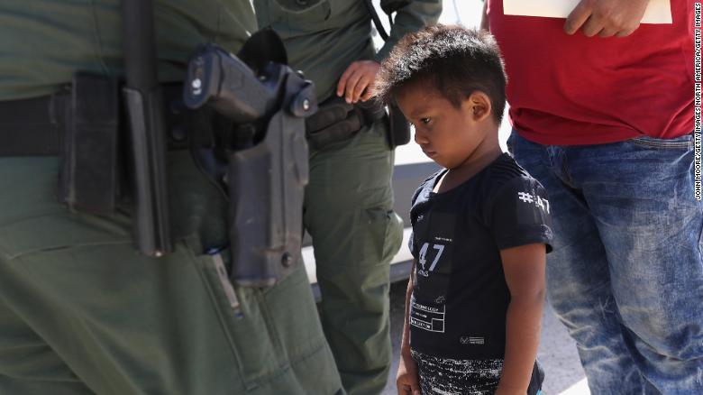A Honduran boy and father seeking asylum in the US were taken into custody by US Border Patrol in June.