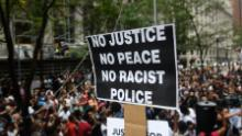 PITTSBURGH, PA - JUNE 21: More than 200 people gathered for a rally to protest the fatal shooting of an unarmed black teen at the Allegheny County Courthouse on June 21, 2018 in Pittsburgh, Pennsylvania. The rally comes in the aftermath of the fatal shooting of Antwon Rose by an East Pittsburgh police officer Tuesday night as the 17-year-old ran after being stopped by police in a vehicle suspected of being involved in an earlier shooting. The organizers called on Allegheny County District Attorney Stephen Zappala Jr. to bring criminal charges against the officer.  (Photo by Justin Merriman/Getty Images)