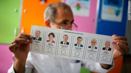 A polling station worker holds a ballot in the mainly-Kurdish city of Diyarbakir in southeastern Turkey on Sunday.
