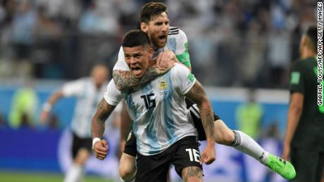 Rojo and Messi celebrate Argentina's late winner against Nigeria