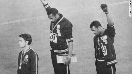 Tommie  Smith  and  John  Carlos raise their fists on the podium at the 1968 Olympics