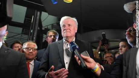 Horst Seehofer speaks to journalists early Monday after late-night talks with the CSU leadership.