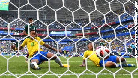 Neymar opens the scoring against Mexico.