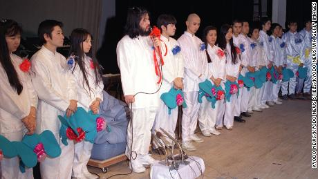 Photo taken Jan. 7, 1990 shows Aum Shinrikyo cult group founder Shoko Asahara (fourth from left) speaking at a press conference in Tokyo to announce a plan to field candidates for the general election.