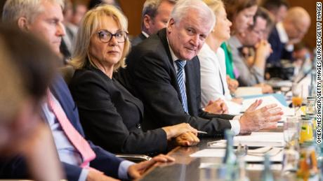 """German Interior Minister Horst Seehofer (C) presents his controversial """"migration master plan"""" on July 10."""