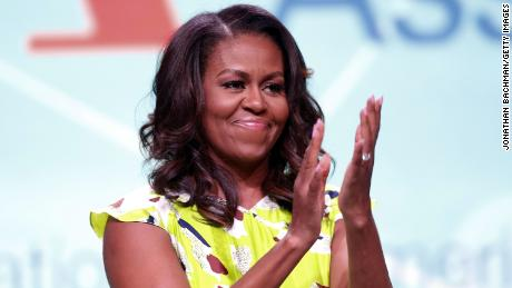 Michelle Obama waves after discussing her forthcoming memoir titled, 'Becoming', during the 2018 American Library Association Annual Conference on June 22, 2018 in New Orleans, Louisiana.  (Photo by Jonathan Bachman/Getty Images)