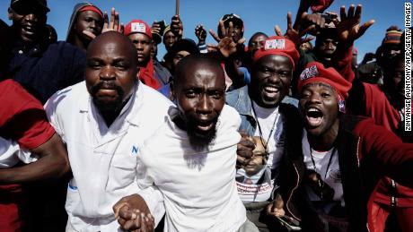 Movement for Democratic Change supporters cheer as they gather to listen to their leader Nelson Chamisa.