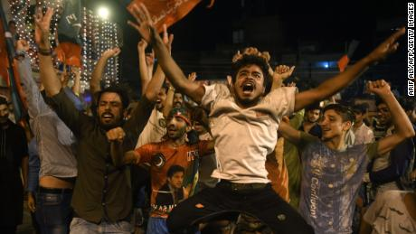 Supporters of Pakistan's cricketer-turned politician Imran Khan, head of the Pakistan Tehreek-e-Insaf (Movement for Justice) party, celebrate during general election in Lahore on July 25, 2018.