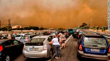 Cars are blocked after a wildfire caused a road closure in Kineta in  Greece on July 23.