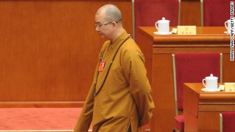 Buddhist Master Xuecheng arrives at the opening session of the Chinese People's Political Consultative Conference in Beijing in March 3.