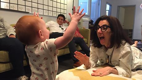 Aline Brosh McKenna plays with one of her staff writer's infants at the production offices for 'Crazy Ex Girlfriend.'