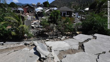 Cracked concrete and damaged houses are pictured in Pemenang,  northern Lombok.