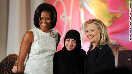 Samar Badawi, center, receiving the 2012 International Women of Courage Award during a ceremony with then-US First Lady Michelle Obama, left, and then-US Secretary of State Hillary Cllinton.