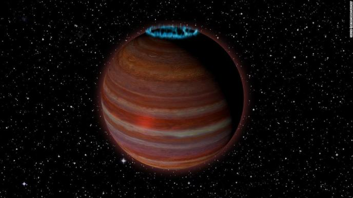 This is an artist's concept of what SIMP J01365663+0933473 might look like. It has 12.7 times the mass of Jupiter but a magnetic field 200 times more powerful than Jupiter's. This object is 20 light-years from Earth. It's on the boundary line between being a planet or being a brown dwarf.