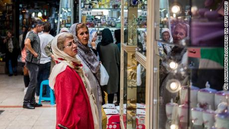 Customers browse goods on display in a store window inside the Grand Bazaar in Tehran.