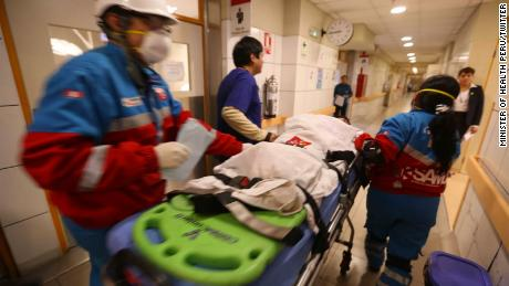 A young food-poisoning victim arrives to be treated at a hospital in Lima.