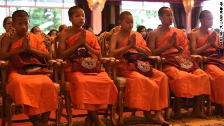Members of the Wild Boars soccer team at a ceremony to mark the end of their retreat as novice Buddhist monks.