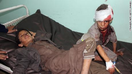 Yemeni children receive treatment at a hospital after being wounded in the August 9 strike.